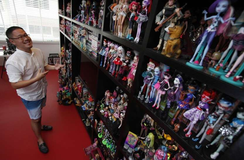 Barbie collector Jian Yang talks about his collection at his home in Singapore