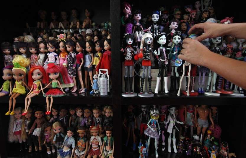 Collector Jian Yang arranges his Monster High dolls among other dolls at his home in Singapore