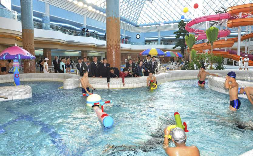 Spectators watch people use The Munsu Water Park in Pyongyang in this undated photo released by North Korea's KCNA
